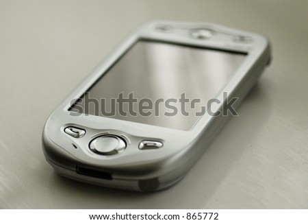 Handheld phone/PDA on a white surface - noise