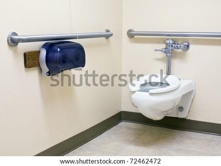 Handicap Bathroom With Grab Bars On The Walls