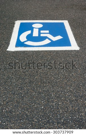 handicap, disabled parking sign painted on the asphalt - stock photo