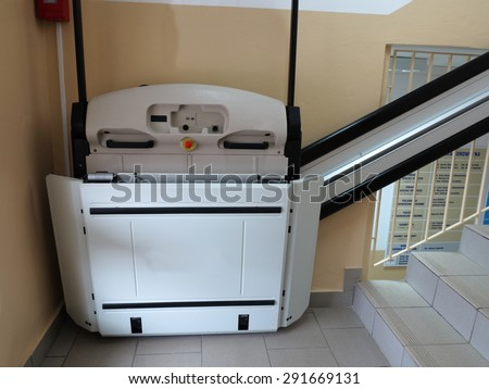 handicap elevator, special lift for invalid wheelchair - stock photo