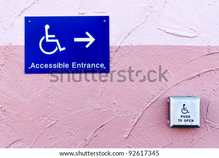 handicap entrance sign and button with handicap sign - stock photo