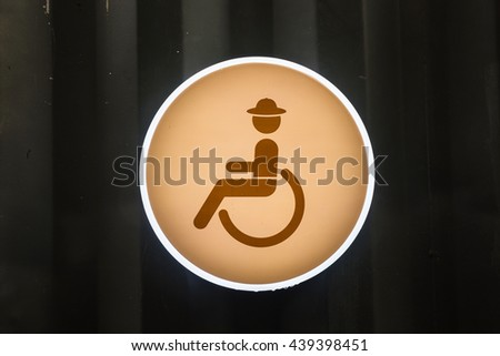 Handicap or Disabled toilet sign on zinc wall - stock photo
