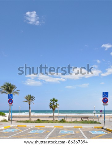 Handicap Parking at Mediterranean Beach in Urbanova a Costa Blanca City in the province of Alicante Spain Europe - stock photo