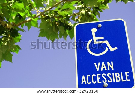 Handicap parking sign blue sky, room for copy space - stock photo