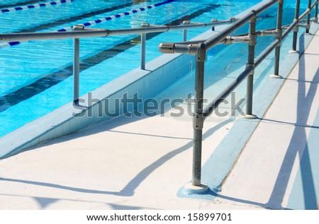 Handicap ramp leading into community swimming pool - stock photo