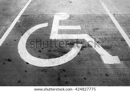 Handicap sign for handicap persons parking car lot at the store for more conveniences use for background texture - stock photo