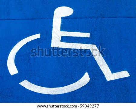 handicap sign painted on cement - stock photo
