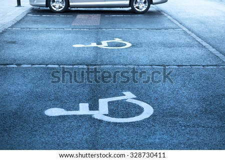 Handicap symbol on parking space - stock photo