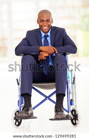 handicapped african american businessman sitting on wheelchair - stock photo