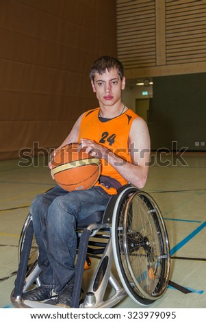Handicapped boy in basketball training. - stock photo