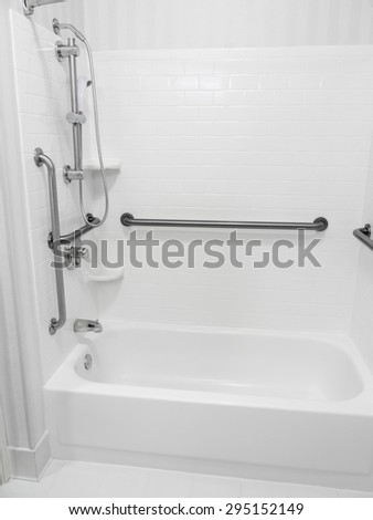 Handicapped disabled access bathroom bathtub shower with grab bars - stock photo