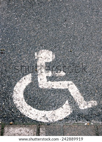 handicapped  / disabled parking sign painted on asphalt - stock photo