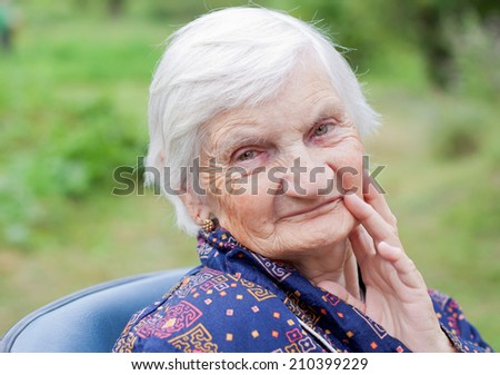 Handicapped elderly woman sitting in a wheelchair