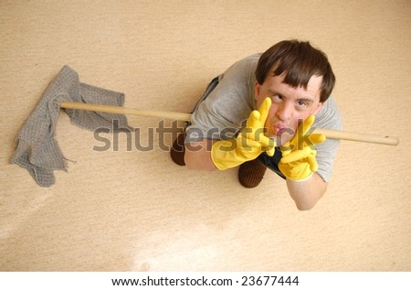 Handicapped man cleaning with mop - stock photo