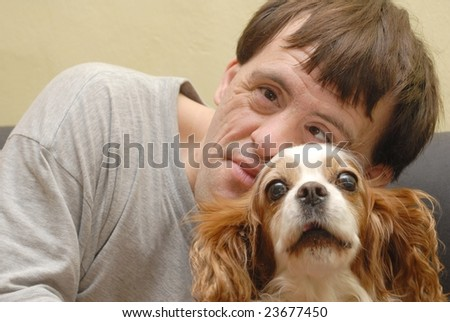 Handicapped man - dog therapy - stock photo
