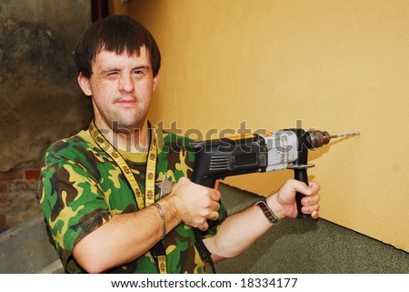 Handicapped man drilling - stock photo