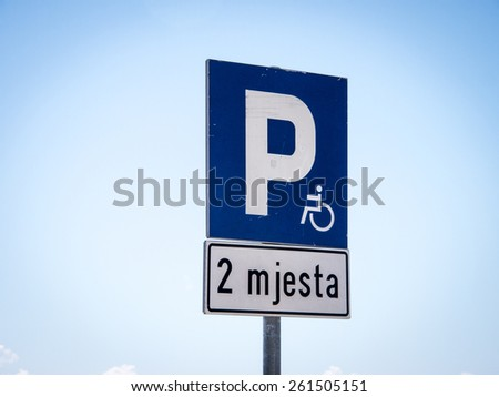 handicapped parking sign, 2 mjesta - 2 hours - stock photo
