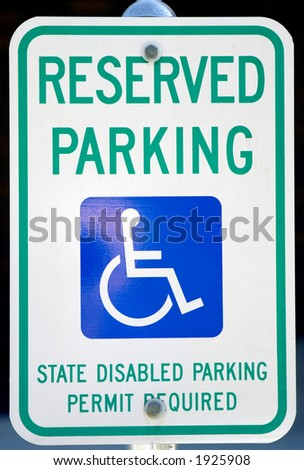 Handicapped parking sign up close. - stock photo