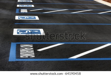 Handicapped parking spaces - stock photo