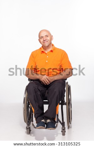 Handicapped person on a wheelchair isolated on white. Wheelchair user. - stock photo