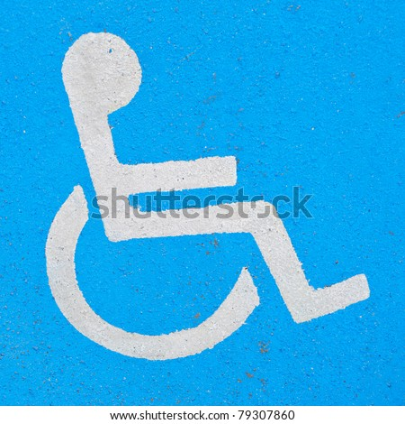 Handicapped sign, icon or logo painted on asphalt - stock photo
