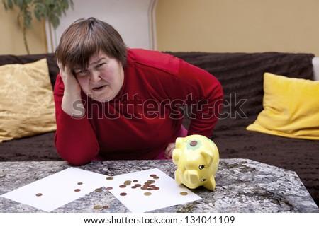 handicapped woman look desperate in front of her bills - stock photo
