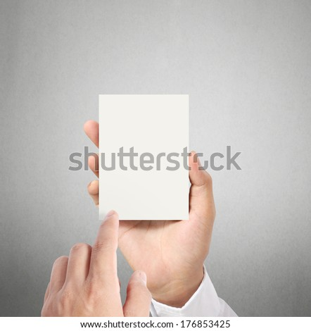 handing a blank business  card over in hand  - stock photo