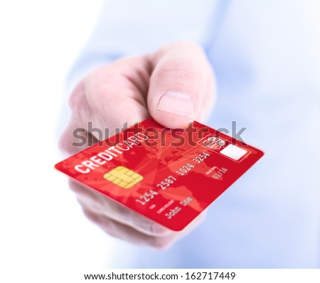Handing out red credit card - stock photo
