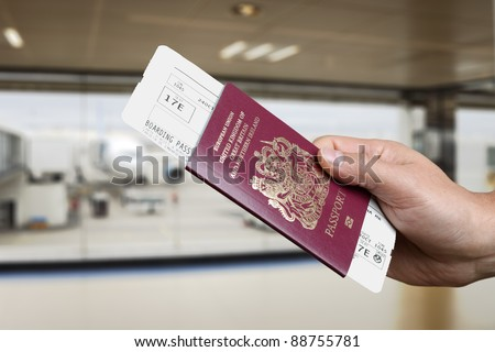 Handing over boarding pass and passport to embark on a flight in an airport
