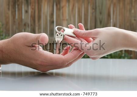 Handing over keys - stock photo