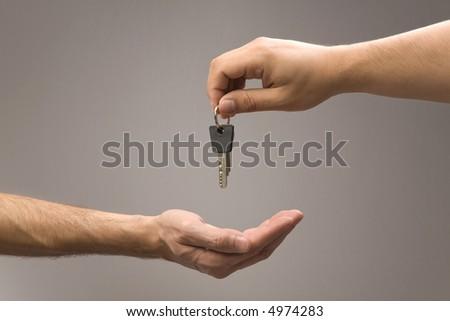 Handing over keys to new owner. - stock photo