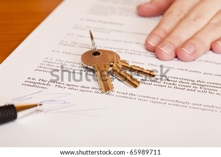 Handing over of keys after contract signing of house sale. Isolated on white background.