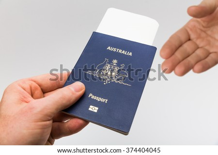 Handing over passport at border control high resolution - stock photo