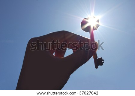 Handing over the key - stock photo