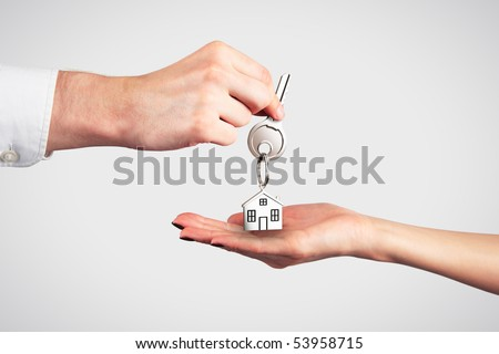 Handing Over the Key from a New Home - stock photo