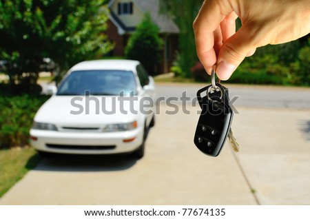 Handing over the keys to a used car.