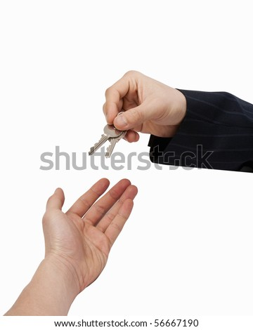 Handing over the Keys [with Clipping Path and isolated on white background] Hand of businessman passing a set of keys to another hand. - stock photo