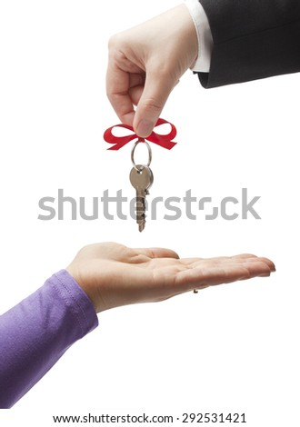 Handing the keys to the new owner - stock photo