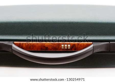 handle and combination lock briefcase expensive business class close-up - stock photo