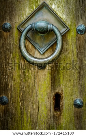 Handle And Keyhole Of Closed And Locked Ancient Wooden Church Door - stock photo