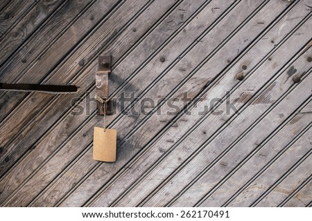 Handle and Tag on a Slanted Wooden Background - stock photo
