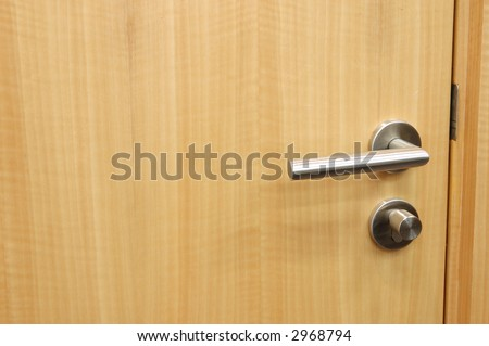Handle of an office wood door