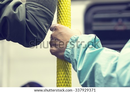 Handle on ceiling of bus,handle on a train,The handle on the MRT, prevent toppling.underground railway system or metro - stock photo