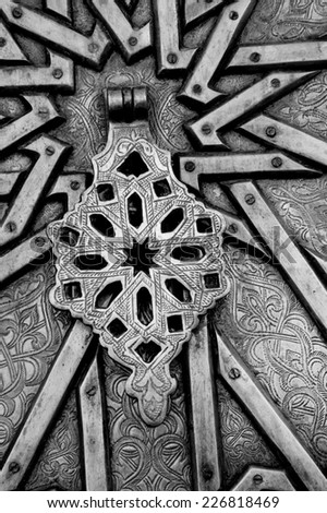 Handle on ornate door in Old Jaffa. Architectural detail. (Tel Aviv-Jaffa, Israel) Aged photo. Black and white. - stock photo