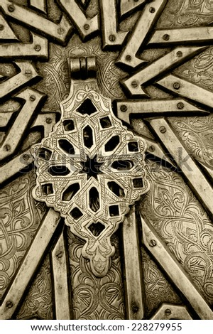 Handle on ornate door in Old Jaffa. Architectural detail. (Tel Aviv-Jaffa, Israel) Aged photo. Sepia. - stock photo