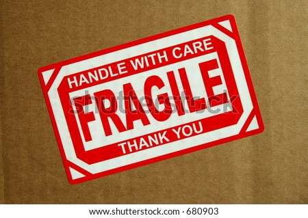 Handle with Care, Fragile sticker on cardboard box