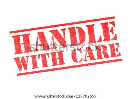 HANDLE WITH CARE rubber stamp over a white background. - stock photo