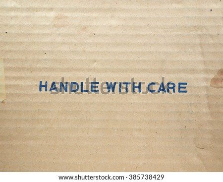 Handle with care tag on a corrugated cardboard packet