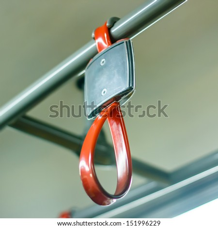 Handles for standing passenger in electric train in thailand - stock photo