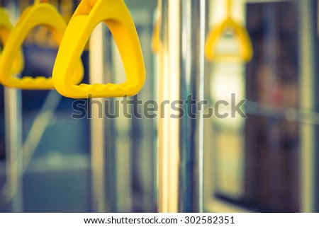 Handles passenger inside a bus.  ( Filtered image processed vintage effect. ) - stock photo